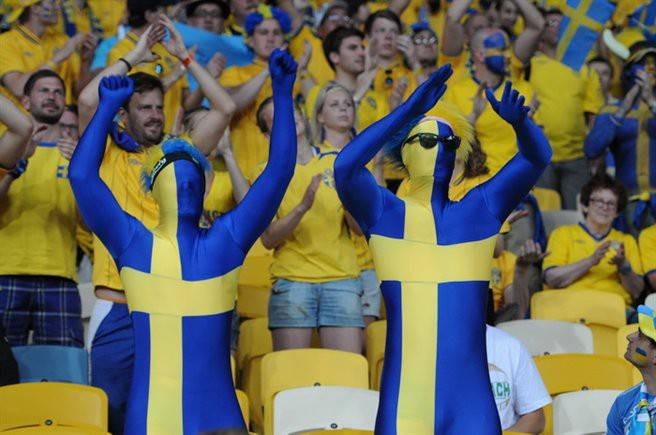 Swedes dressed in Swedish flags