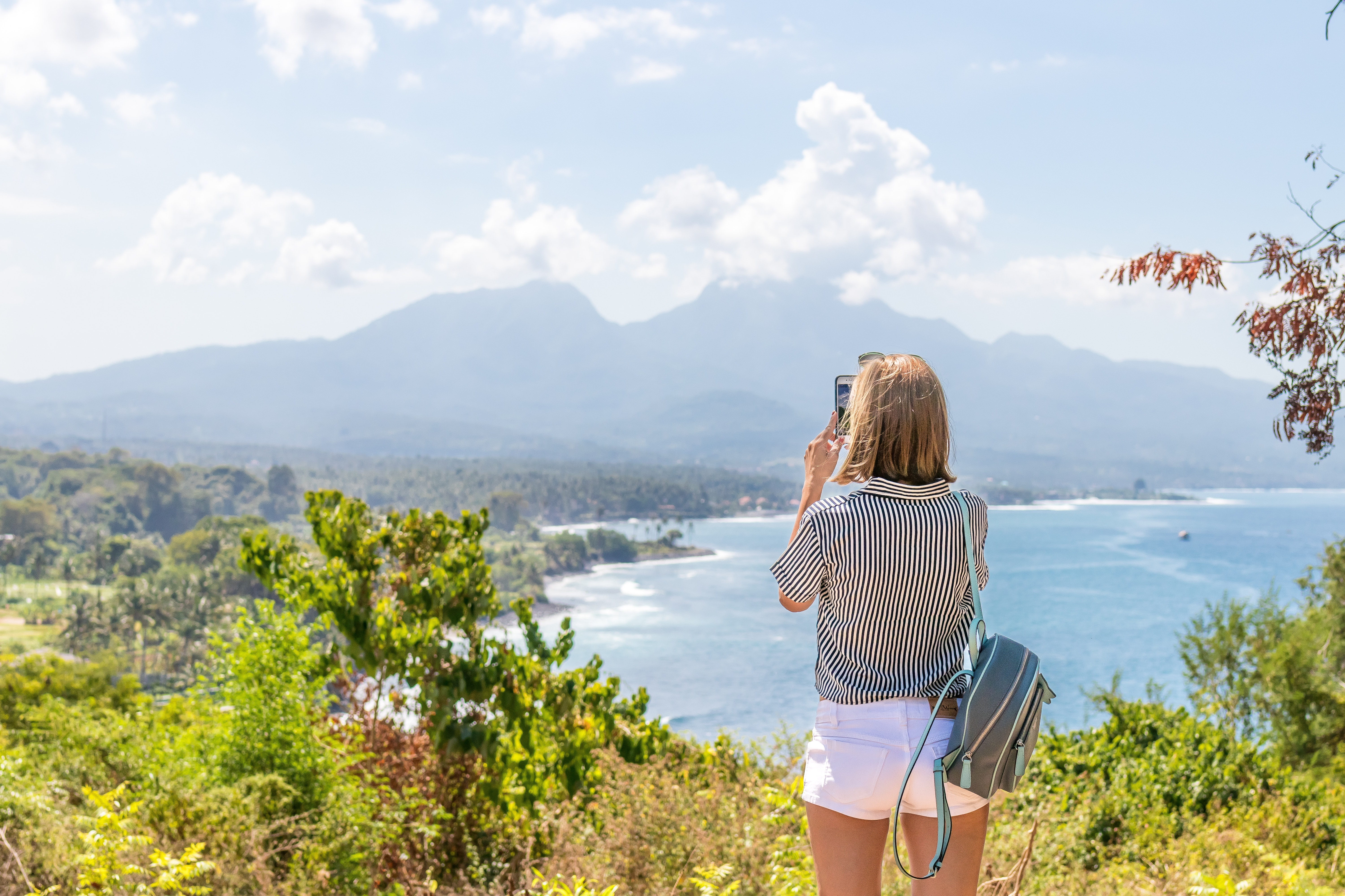 Woman traveling alone in front of landscape