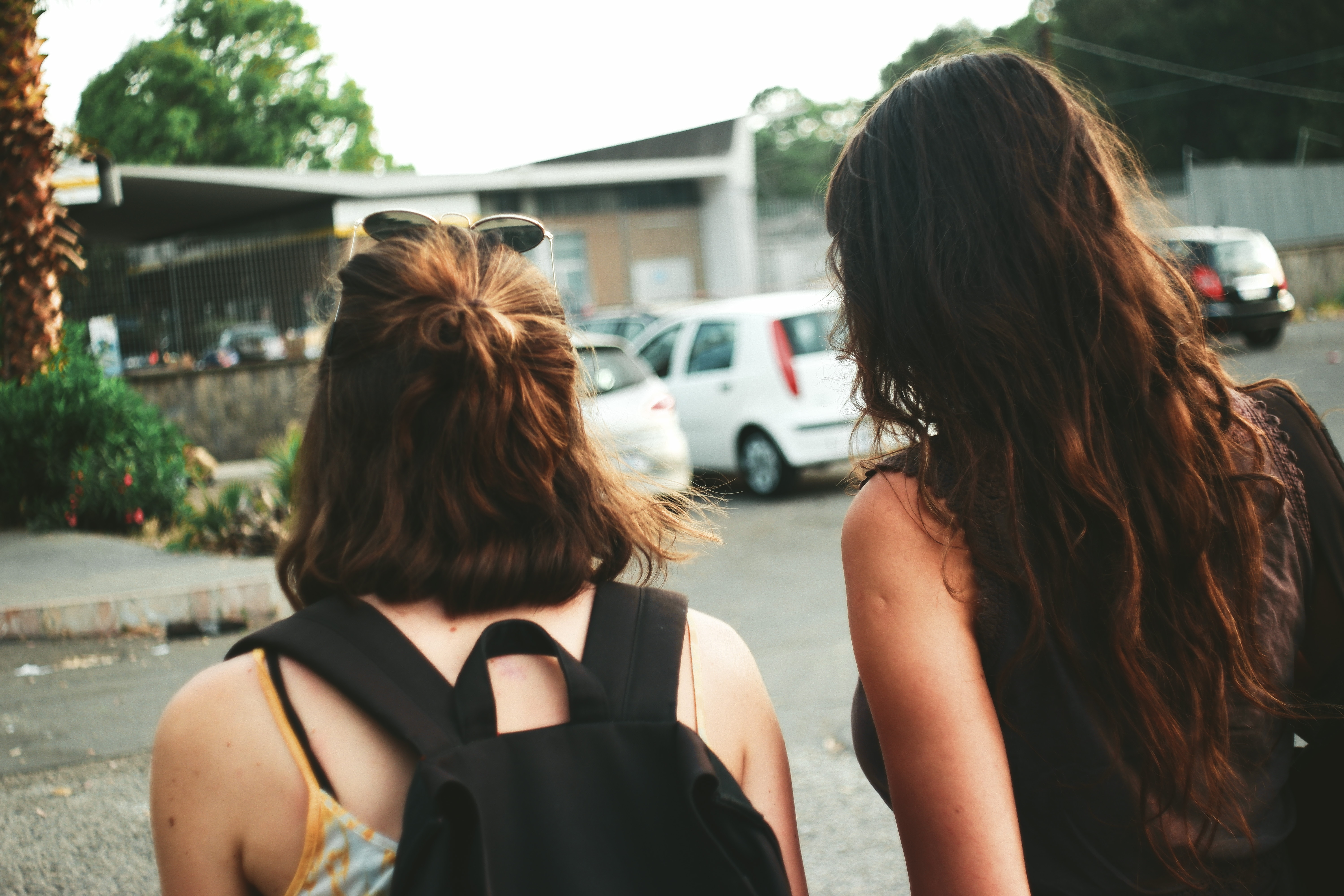 Two friends walking down the street together