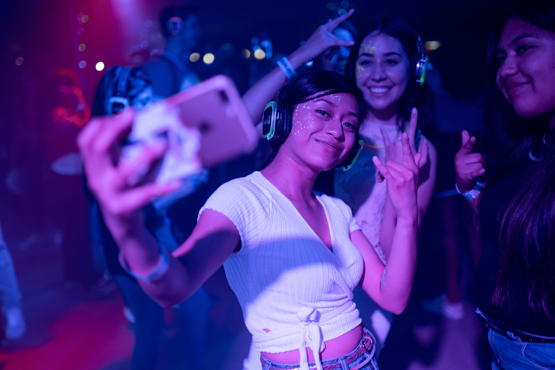 Women taking selfie at a club