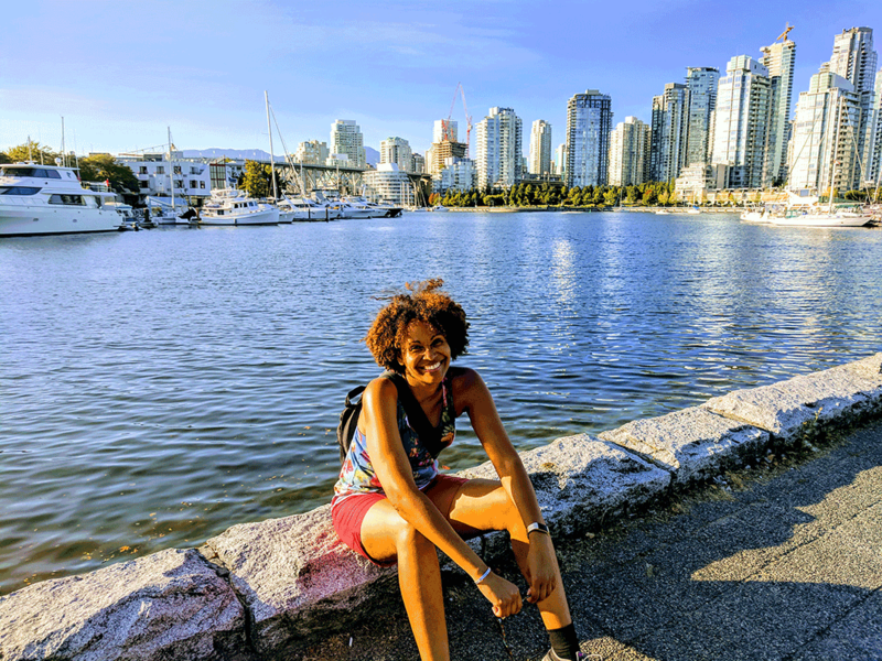 Yoanne Clovis sitting on the quays of Vancouver.